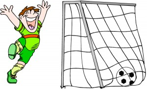 Happy soccer boy w goal